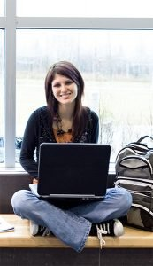 teen girl with computer