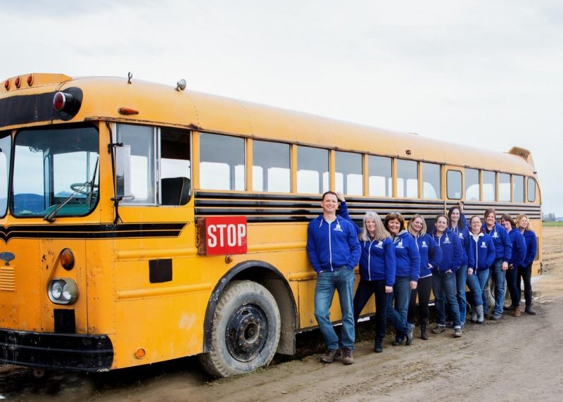 Apex Learning Virtual School - some of our staff in front of an school bus