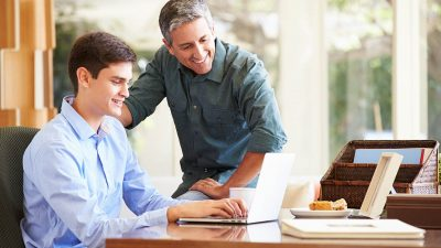 Father And Teenage Son Homeschooling