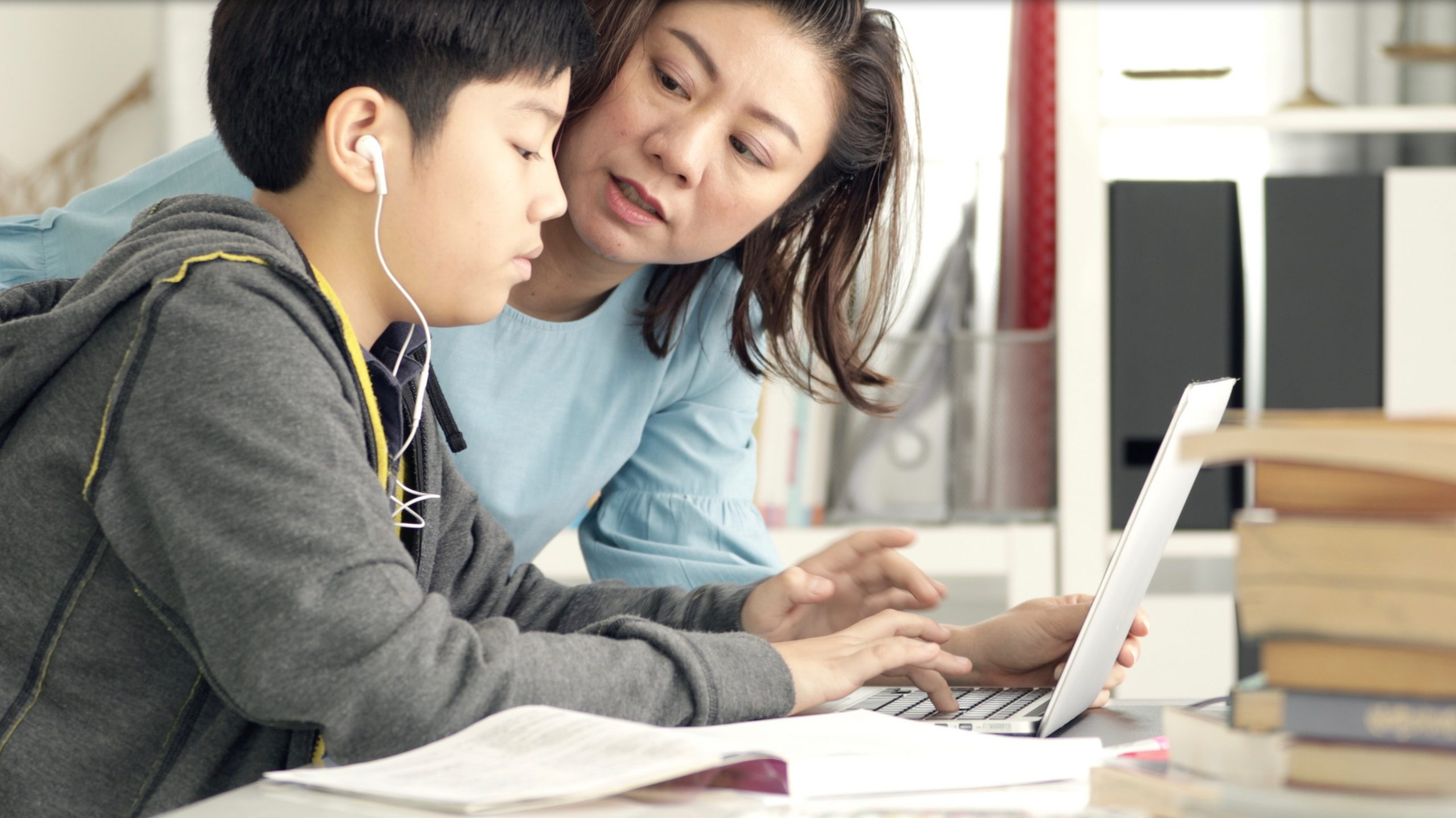 Mom helping middle school student with essential learning skills