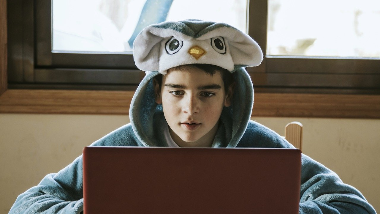 Student in costume attending virtual school