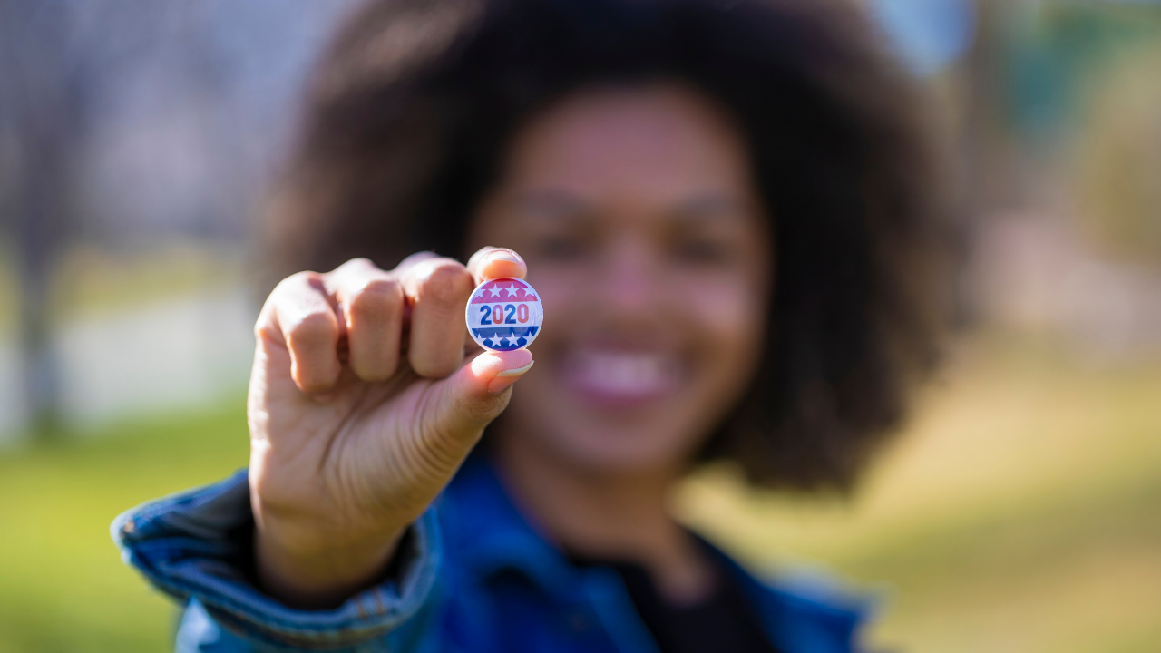 Young Voter holding voter pin